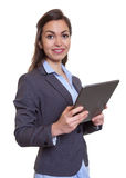 Modern businesswoman with brown hair and tablet computer Royalty Free Stock Photo