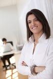 Modern businesswoman at her office Stock Photos