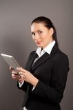 Modern businesswoman holding tablet computer Stock Photos