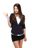 Modern businesswoman pointing towards copyspace Stock Photos