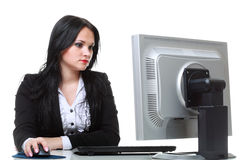 Modern businesswoman sitting at office desk Royalty Free Stock Images