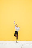 Modern businesswoman success and motivation. Joyful trendy businesswoman celebrating job success outside. Successful modern female worker wearing skirt and Royalty Free Stock Images