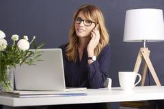 Modern businesswoman at work royalty free stock photo