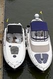 Modern cabin cruisers. Overhead view of two modern cabin cruiser boats moored by pier Royalty Free Stock Image