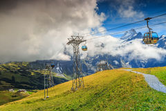 Modern cableway and green fields,Grindelwald,Switzerland,Europe Stock Images