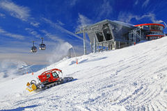 Modern cableway and groomer in ski resort Jasna, Slovakia Royalty Free Stock Photo