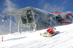 Modern cableway and groomer in ski resort Jasna, Slovakia Stock Photos