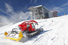 Modern cableway and groomer in ski resort Jasna, Slovakia Royalty Free Stock Photography