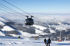 Modern cableway in ski Resort Jasna, Slovakia. JASNA, SLOVAKIA - February 12: Modern cableway going from Priehyba to Rotunda, Chopok - 2024m, Funitel, in ski stock image