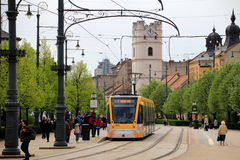 Modern CAF Urbos tram in Debrecen, Hungary. DEBRECEN/HUNGARY - APRIL 18, 2015: Modern CAF Urbos tram on the main street of Debrecen. Many Central and Eastern Stock Photography
