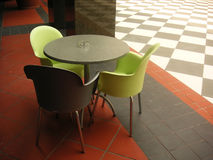 Modern cafe. With colored plastic chairs Royalty Free Stock Image