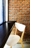 Modern cafe corner with brick wall Royalty Free Stock Photography