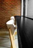 Modern cafe corner with brick wall chair and window Stock Photo