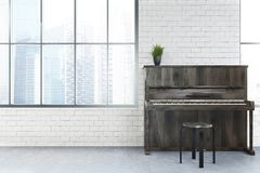 White cafe interior, piano. Modern cafe interior with white brick walls, tall windows, a concrete floor and a piano. 3d rendering mock up Royalty Free Stock Photos