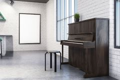 White cafe interior, piano, poster. Modern cafe interior with white brick walls, tall windows, a concrete floor and a piano. A framed poster on the wall. 3d Stock Photos