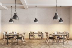 White brick cafe interior. Modern cafe interior with wooden tables and chairs near white brick walls. Original ceiling lamps. 3d rendering mock up Stock Photos