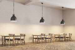 White brick cafe interior side view. Modern cafe interior with wooden tables and chairs near white brick walls. Original ceiling lamps. A side view. 3d rendering Stock Photos