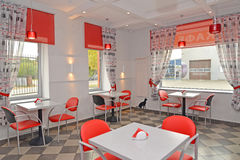 Modern cafe in red and light tones. Interior Stock Photos