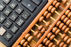 Modern calculator and abacus Royalty Free Stock Photo