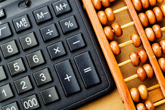 Modern calculator and abacus Royalty Free Stock Photography
