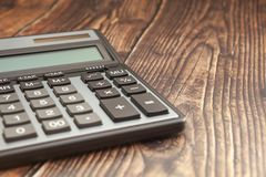 Modern calculator on a wooden table, business concept, close-up stock photo
