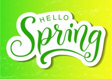 Modern calligraphy lettering of Hello Spring in green with shadow in paper cut style on yellow green background royalty free stock images