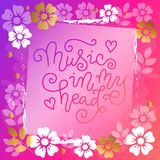 Modern calligraphy lettering of Music in my head in pink on pink background with flowers stock illustration