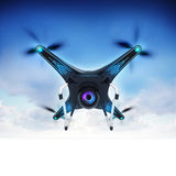 Modern camera drone in air with blue sky background Royalty Free Stock Photo