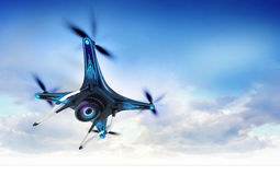 Modern camera drone in flight with blue sky Royalty Free Stock Image