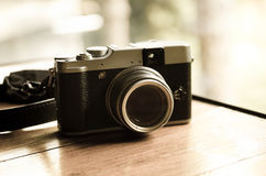 Modern camera in vintage style Royalty Free Stock Photo