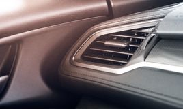 Modern car air condition outlet with flare light effect and copy stock photography