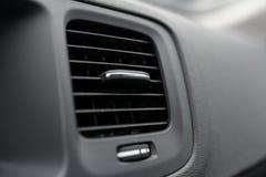 Modern car air condition vents. Vehicle interior stock photos