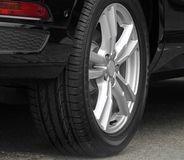 Modern car alloy wheel Royalty Free Stock Photos