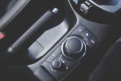 Modern car audio entertainment control button. Close up of modern car audio entertainment control button stock photography