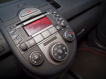A modern car centre console. A modern car centre console view with car audio system and air condition. Shallow depth of field, focus on ac knobs Stock Image