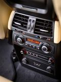 Modern car climate control panel for passengers in rear row with shallow depth of field. Four zone climate control. Car interior detail. Back passenger air stock photos