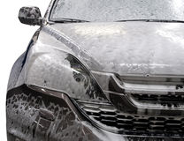Modern car covered by foam. Stock Photography