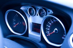 Modern car dashboard. Looking at modern car dashboard with tungsten light effect stock image