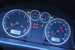 A Modern Car Dashboard. A closeup on the dashboard of a modern car with focus on the temperature and fuel indicators Royalty Free Stock Photo