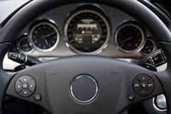 Modern car dashboard. Focus on steering wheel Royalty Free Stock Image