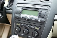 Modern car dashboard, radio system and climate control panel.  royalty free stock images