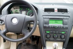 Modern car dashboard, steering wheel, radio system and climate c. Ontrol panel royalty free stock photo