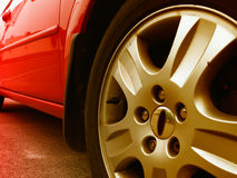 Modern car detail. Angled view of a modern red city car Royalty Free Stock Images