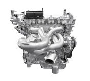 Modern car engine isolated on white background with clipping pat. H royalty free stock photo
