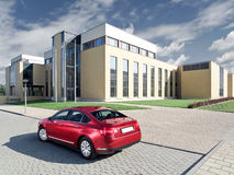 A modern car in front of modern buildings. Royalty Free Stock Photo