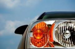 Modern Car Headlight. An abstract of a modern car headlight, with blue sky for copyspace Stock Photo