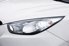 Modern car headlight Stock Photos