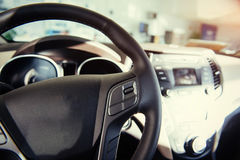 Modern car illuminated dashboard and steering wheel.  Stock Photography