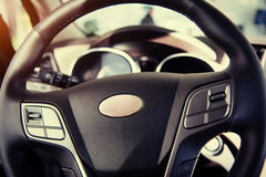 Modern car illuminated dashboard and steering wheel.  Royalty Free Stock Photo