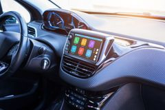 Modern car infotainment system with phone, messages, music, navigation, journey apps.  stock image
